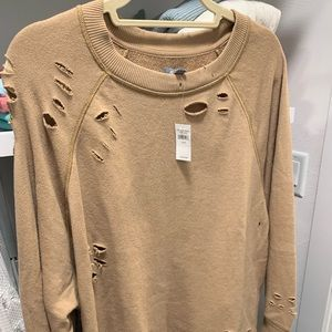 Camel color sweatshirt with rips/distressing.